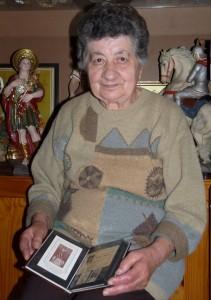 Vitorja Sultana qed turini l-bulettin tal-1956