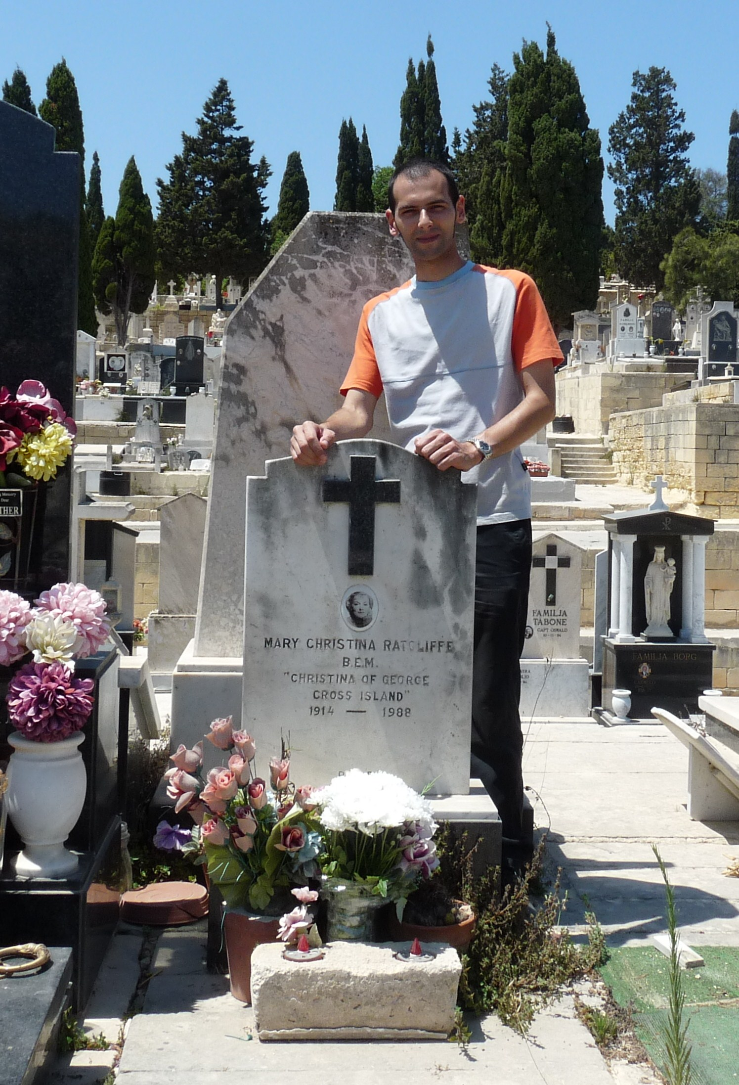 Eman Bonnici standing near Ratcliffe's grave in Addolorata cemetery - 1.JPG