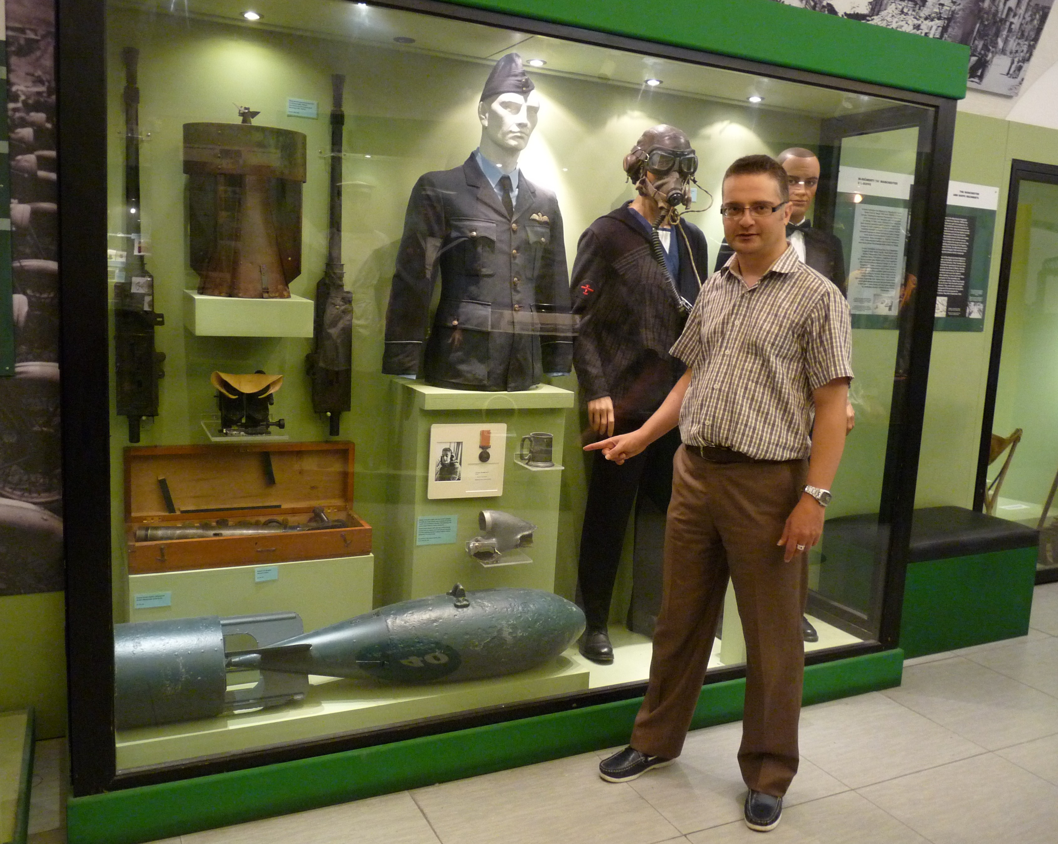 National War Museum Curator Charles Debono near Warburton-Ratcliffe exhibits - 1.JPG