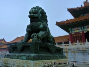Lioness stands in front of Gate of Supreme Harmony in Forbidden City