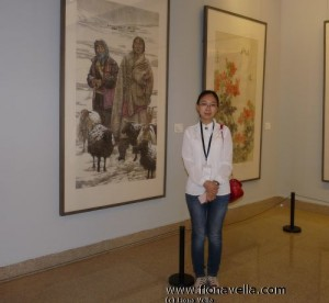Artist Liu Xia besides her work at the National Art Museum of China - Photo by Fiona Vella