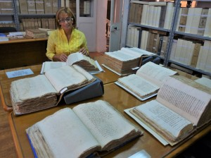 Dr Joan Abela with the Notarial Archives' manuscripts (Photo - Fiona Vella)