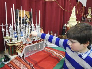 John Paul Buhagiar Smith, one of the youngest members of the society, decorating his model-altar (Photo - Fiona Vella)