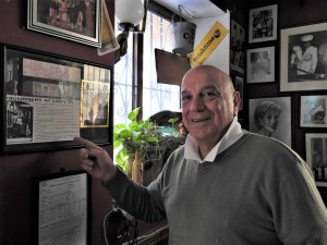 Frankie Cutajar showing The People's feature about him and his pub (Photo - Fiona Vella)